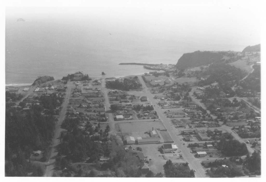Aerial view of Port Orford facing west to the Pacific Ocean captured March 22, 1980.