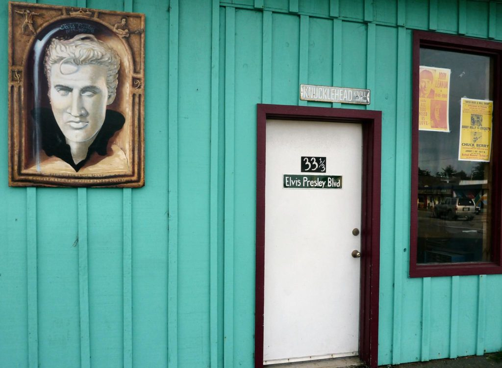 The side door of the Downtown Fun Zone building with an Elvis Presley portrait by artist Darren Evans.