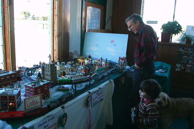 Evan and Nathan Malamud talk trains at the Downtown Fun Zone.