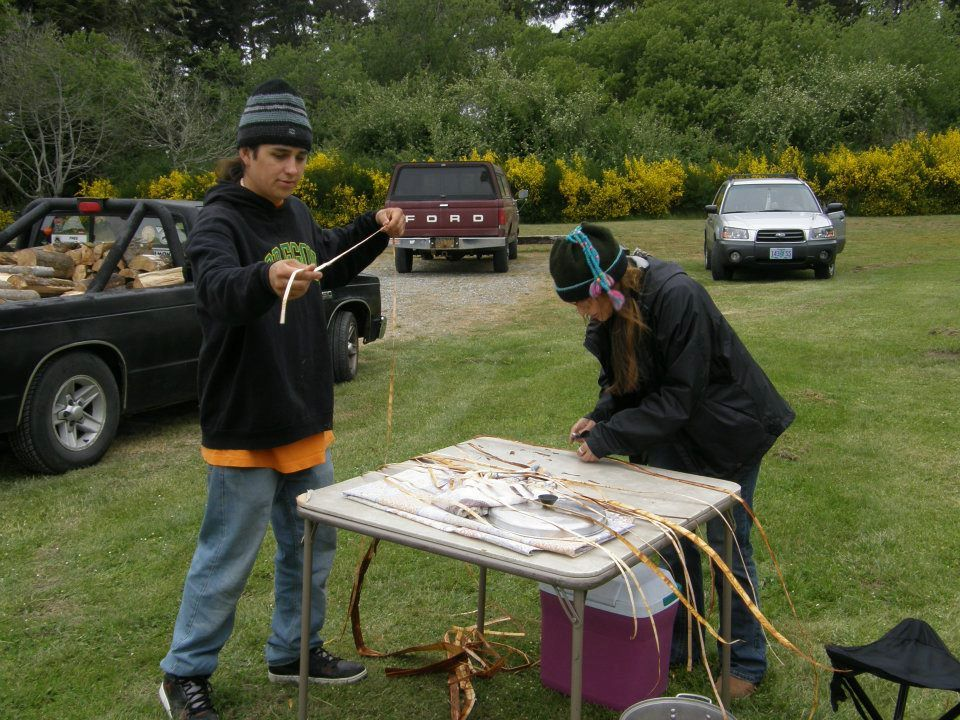 Kyle Towner and Catherine Dupaquier   making a cedar bark mat to put the fish  bones on